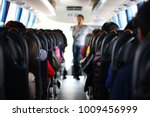 the passengers in the bus... | Shutterstock . vector #1009456999