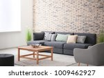 comfortable sofa with pillows... | Shutterstock . vector #1009462927
