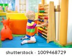 child playing with wooden... | Shutterstock . vector #1009468729