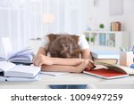tired student sleeping at her... | Shutterstock . vector #1009497259
