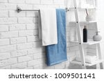 clean towels on rack in bathroom | Shutterstock . vector #1009501141