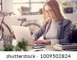 young woman working on laptop | Shutterstock . vector #1009502824