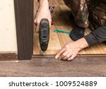 a man is making a threshold on... | Shutterstock . vector #1009524889