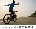 cyclist riding bike with arms... | Shutterstock . vector #1009545151