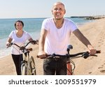 happy elderly man with woman in ... | Shutterstock . vector #1009551979