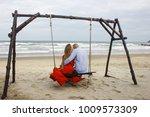 love romantic people ocean beach | Shutterstock . vector #1009573309