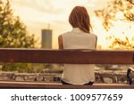 woman sitting on a bench and... | Shutterstock . vector #1009577659
