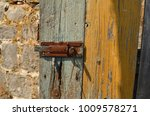 Old Cracked Wooden Gate With...