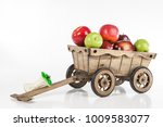 A Wooden Cart With Apples. The...