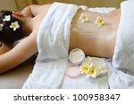 woman getting a cream spa... | Shutterstock . vector #100958347
