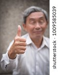 Small photo of senior giving thumb up gesture, happy, smiling accepting approving old man