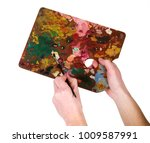 hands with colors palette and... | Shutterstock . vector #1009587991
