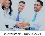 business people shaking hands... | Shutterstock . vector #1009602391