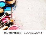 various makeup products on dark ... | Shutterstock . vector #1009612045