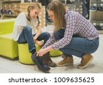 mom chooses winter shoes for...   Shutterstock . vector #1009635625