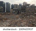 demolish building with debris... | Shutterstock . vector #1009635937