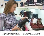 pretty woman choosing children... | Shutterstock . vector #1009636195