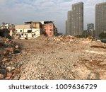 demolish building with debris... | Shutterstock . vector #1009636729