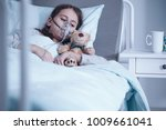 kid with cystic fibrosis lying... | Shutterstock . vector #1009661041