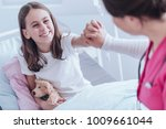 high angle of girl with plush... | Shutterstock . vector #1009661044
