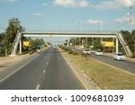 bridge across the road  cars... | Shutterstock . vector #1009681039