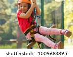 little beautiful girl climbs on ... | Shutterstock . vector #1009683895