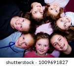 group of little girls laying on ... | Shutterstock . vector #1009691827