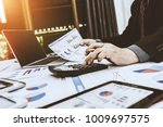 financiers are calculating... | Shutterstock . vector #1009697575