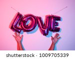 the hands of a young man and...   Shutterstock . vector #1009705339