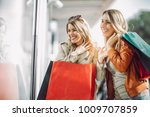 happy friends shopping. two... | Shutterstock . vector #1009707859