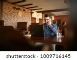 young freelancer working with... | Shutterstock . vector #1009716145