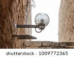 lamp on street of stone old...   Shutterstock . vector #1009772365