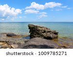 A rocky outcropping near the shore of Lake Michigan in the summer in Cave Point County Park, Sturgeon Bay, Wisconsin, USA