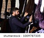 winter clothing concept. man... | Shutterstock . vector #1009787335