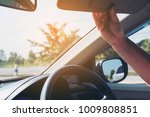lady adjust sun visor while... | Shutterstock . vector #1009808851