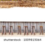 Stock photo beach bar with wood chair on sand and thatched roof tropical hawaii concept on white isolated 1009815064