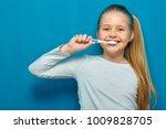 little girl with long blonde...   Shutterstock . vector #1009828705