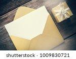 open yellow paper envelope with ... | Shutterstock . vector #1009830721
