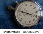 stopwatch on worn blue jeans... | Shutterstock . vector #1009839391