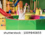 adorable little boy smiling at... | Shutterstock . vector #1009840855