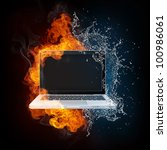 Laptop in Fire and Water isolated on black Bacground. - stock photo