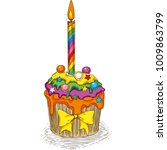 Rainbow Cupcake With Candle On...
