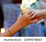 give food by hand | Shutterstock . vector #1009878865