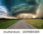 huge tornado along a road in...