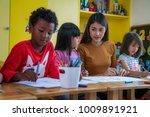 asian teacher and student in an ... | Shutterstock . vector #1009891921