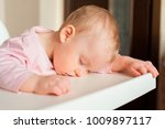 tired child sleeping in... | Shutterstock . vector #1009897117