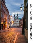 Small photo of Pauline church of St. Spirit and Freta street at night on the old town in Warsaw, Poland