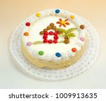 cake with chocolate dragees | Shutterstock . vector #1009913635
