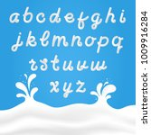 milk font with latin letters.... | Shutterstock .eps vector #1009916284