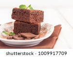 chocolate brownie square pieces ... | Shutterstock . vector #1009917709